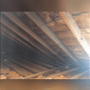 The attic prior to insulation work with Spray Foam