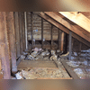The side attic has little to no insulation and it's just scattered about in a haphazard way that really isn't doing anything for the homeowner. It isn't creating a barrier between the home and the outside air whatsoever.