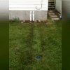 You can't even tell there is a discharge line buried in the homeowners lawn. You might even miss the Bubbler Pot at the bottom of the photo.