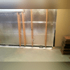 Installation of ThermalDry® Radiant Wall and WaterGuard® Drainage System