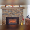 The fireplace was refaced with a barnyard mantle and stacked stone. It gives a beautiful, cozy feeling to the room.