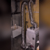 The upper duct kit takes the air from the finished side of the basement and moves it through the machine to pull out the moisture, that filtered, dehumidified air is then taken through the lower duct kit and forced back into the finished side of the basement.