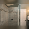 Sharon and Edward loved that we were able to fit in a full glass shower as well as a separatetub in their bathroom withoutmaking it feel too crowded. They love the ample space the design offers.