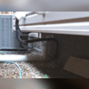 A view of the IceGuard® system installed to allow the excess water to exit the home even if the discharge line was clogged or frozen.