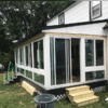 Durable energy efficient windows and sliding doors were installed. The Argon-filled, Low E, double pane insulated tempered glass will keep the warm or cold air outside where it belongs.