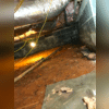 The crawl space has serious water damage and falling insulation.