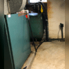 The basement suffered from repeated flooding that caused water damage and mold.