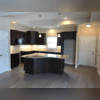 The lighting in the kitchen complements the layout/design of it very well and makes the entire room much more inviting. The LED recessed cans on the ceiling allow for the overall illumination of the room, the under cabinet lighting illuminates the surface of the counter tops more, which is very...