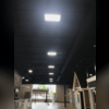 Here is a view of LED high bay lighting throughout the ceiling in the showroom to illuminate all of the small scale homes.