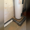 The Fortress Team installed a Trench Drain around the water heater to ensure no water could touch it.