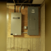 This 200 amp electrical panel (on the right) will provide ample power for all of the electrical needs in the home, as well as the addition of the new AC unit to keep the homeowners cool in the summer heat. Pictured on the left is the transfer switch which will ensure the generator is able to...