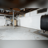 They hired Fortress Foundation Solutions to solve these problems. We installed a full perimeter WaterGuard with a TripleSafe. Sump System. We also installed a CleanSpace Liner so the walls will stak clean and mold free!