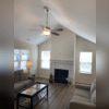 Pictured is a ceiling fan our team installed in the living room, that provides excellent lighting and decor in the room as well.