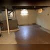 There was extensive water damage throughout the basement due to repeated flooding.