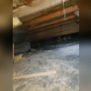 The crawl space had mold and water damage caused by repeated flooding and moisture issues.