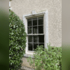 The original window on the side of the home.