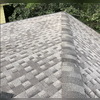 This photo shows the back corner of the roof that's been replaced with impact resistant shingles, GAF Timberline® ArmorShield™ II.