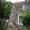 Exhaust line on stone wall