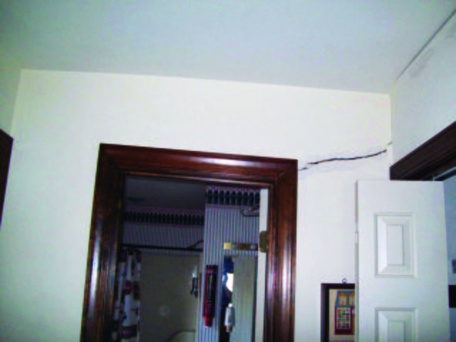 A crack above an interior door can be a sign of a potential foundation issue.
