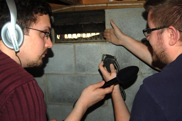 """Colin Reger, Production Manager for Basement Systems of West Virginia, explains to Ben Adducchio, Assistant News Director for West Virginia Public Radio, how open foundation vents actually """"wet"""" crawl spaces, according to the EPA."""