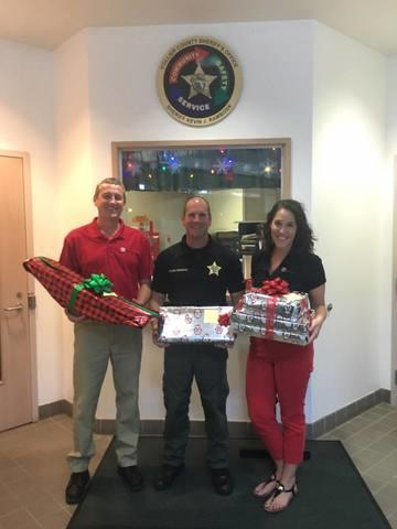 Vice President David Bodzenski and Administrative Manager Christina Nolton drop gift off at the North Naples substation.