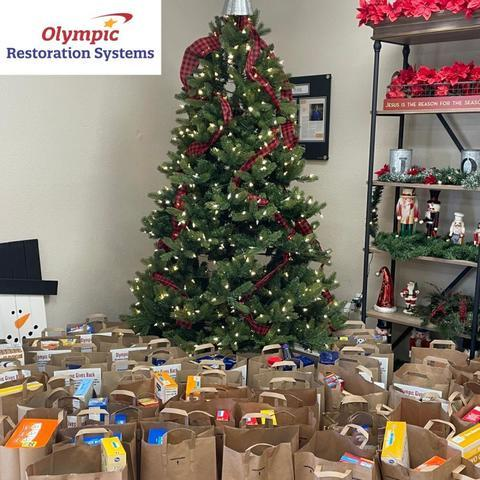 Olympic Restoration Systems Gives Back To Community In Need - Image 1