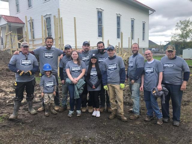 Woodford Team helping to building Wheelchair ramp
