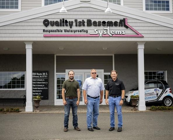 From left to right: General Manager Bob Cherry and Owner Tom Roman of Quality 1st Basement Systems stand in front of their Cliffwood, NJ facility with Contractor Nation CEO and Founder Larry Janesky.