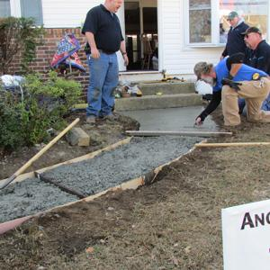 Gov. Chris Christie recognized Quality Concrete's donation to help a couple whose home was destroyed...